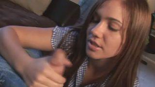 Attractive young girl Dakoda jerking a massive schlong on her knees