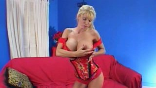 Ponytailed blonde milf Misty Knights stripping and licking her gigantic breasts