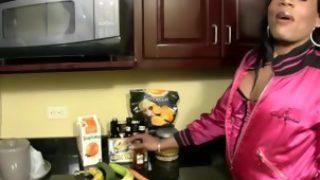 Ebony shebabe in sexy fishnets toys and sucks long cucumber