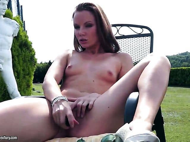Solo girl is massaging her pussy